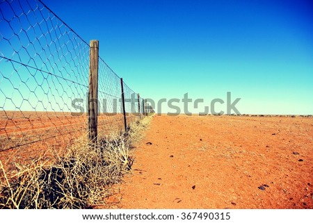 Dingo fence in the Australian outback - stock photo