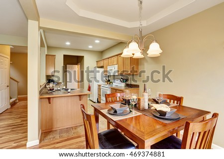 Dining area connected to kitchen room interior. Open floor plan. Northwest, USA