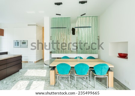 Dining area in a bright house, horizontal - stock photo