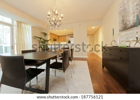 Dining area with magnificent chandelier in stylish townhouse  - stock photo