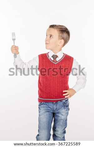 Dining concept. Portrait Hungry Boy holding cutlery fork on hand, hungry for food on white studio background.