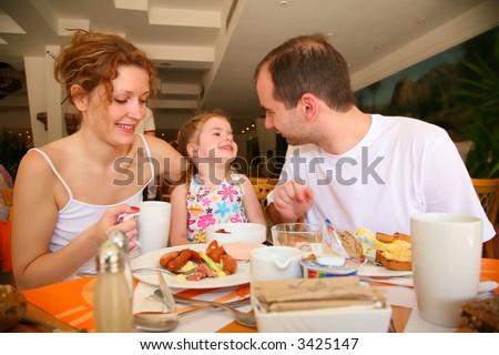 dining family - stock photo