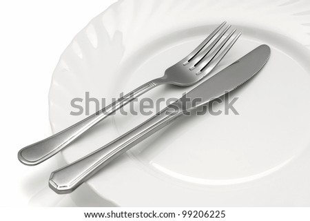 Dining plate with cutlery. - stock photo