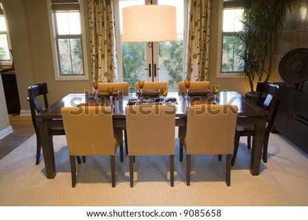 Dining room and table with luxurious decor. - stock photo
