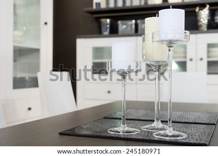 Dining room detail, candles on the table, selective focus - stock photo
