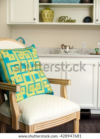 Dining Room Home Staging with Leather White Wooden Chair with Green Yellow Pillow - stock photo