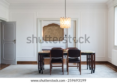 Dining room in classic style villa - stock photo
