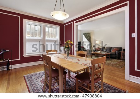 Dining room in condo with red walls