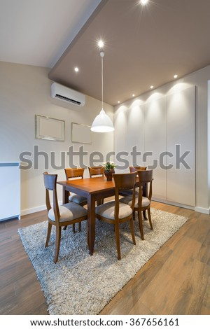 Dining room in loft apartment - stock photo