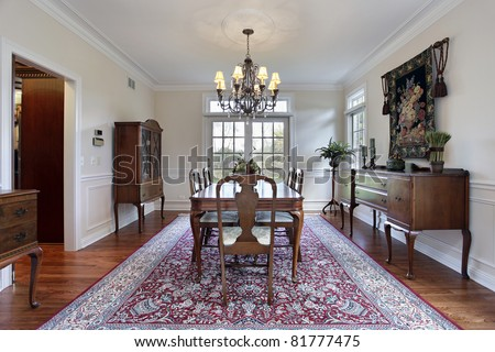 Dining room in luxury home with buffet - stock photo