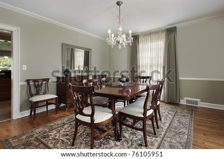 Dining room in luxury home with buffet table - stock photo
