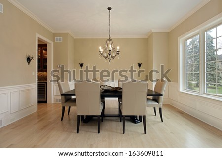 Dining room in luxury home with candle sconces - stock photo
