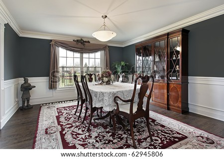 Dining room in luxury home with dark teal walls - stock photo