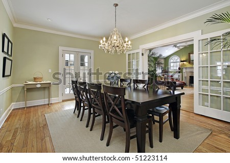 Dining room in luxury home with door to patio - stock photo