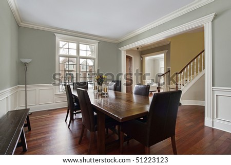 Dining room in luxury home with foyer view - stock photo