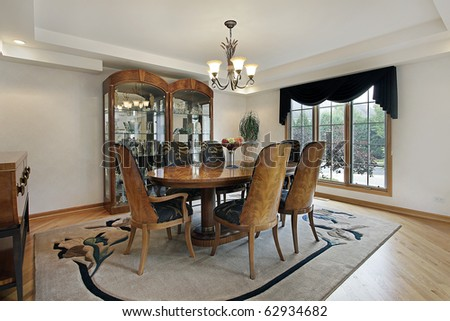 Dining room in luxury home with glass cabinet - stock photo