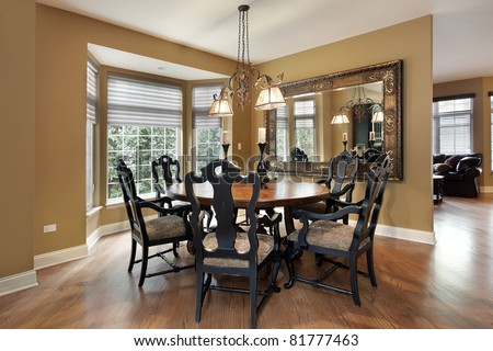 Dining room in luxury home with gold walls - stock photo