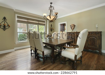 Dining room in luxury home with large buffet - stock photo
