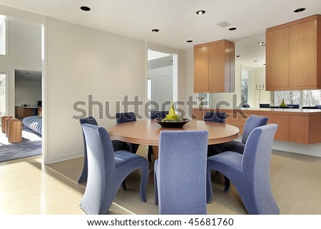 Dining room in luxury home with lavender colored chairs