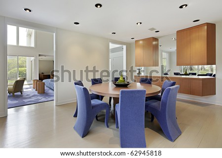 Dining room in luxury home with lavender colored chairs - stock photo