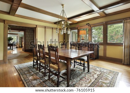 Dining room in luxury home with wood beam ceilings - stock photo