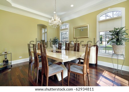 Dining room in luxury home with yellow walls - stock photo