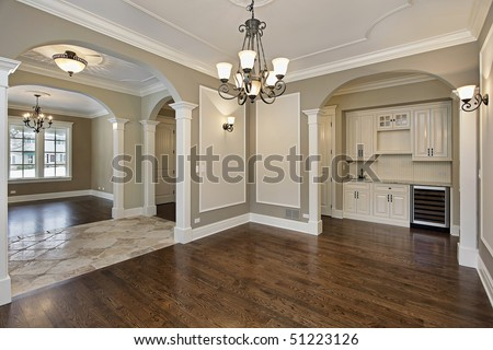 Dining room in new construction home with butler's pantry - stock photo