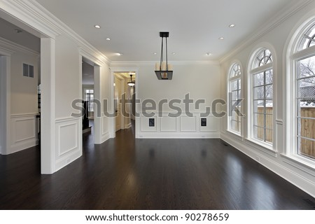 Dining room in new construction home with curved windows - stock photo
