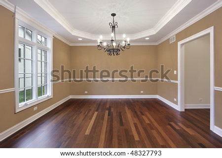 Dining room in new construction home with tan walls - stock photo
