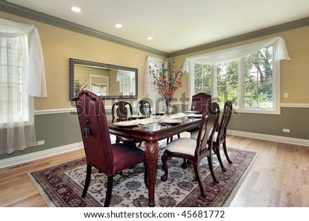 Dining room in new construction home with yellow and green walls - stock photo