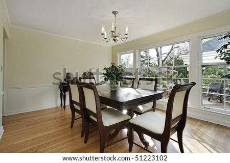 Dining room in remodeled home with patio view - stock photo