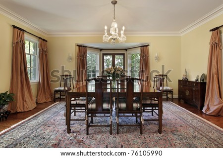 Dining room in suburban home with doors to patio - stock photo