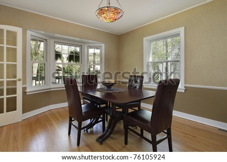 Dining room in suburban home with french doors - stock photo