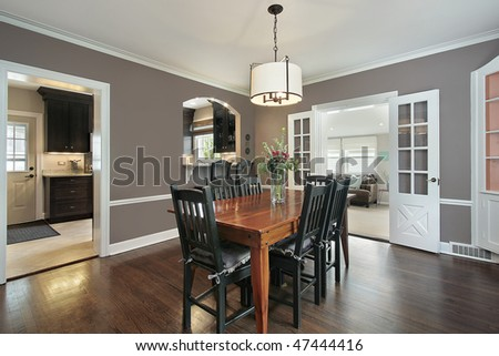Dining room in suburban home with kitchen view - stock photo