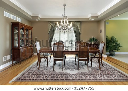 Dining room in suburban home with large carpet - stock photo