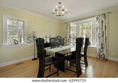Dining room in suburban home with light green walls - stock photo