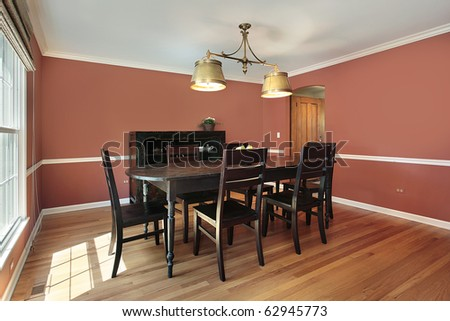 Dining room in suburban home with salmon colored walls - stock photo