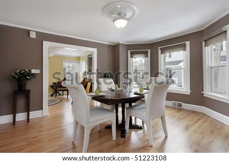 Dining room in suburban home with wall of windows - stock photo