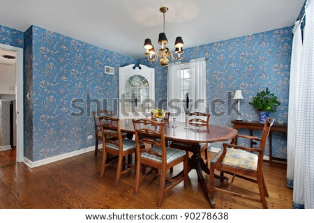 Dining room in traditional home with blue wallpaper - stock photo