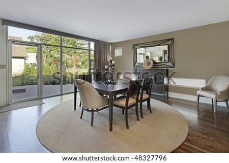 Dining room in upscale townhouse with patio view - stock photo