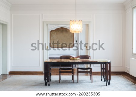 Dining room interior with marble table - stock photo