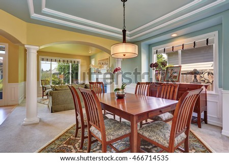 Dining room interior with mint walls and coffered ceiling. Northwest, USA