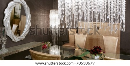 dining room modern crystal strass lamp and crocodile golden chairs - stock photo
