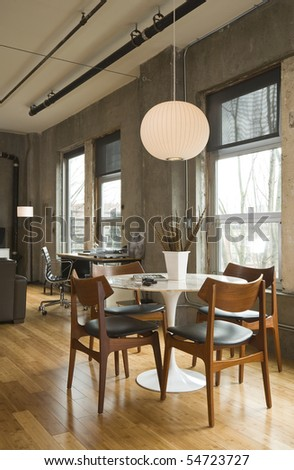 Dining room table and desk in a modern loft setting. Vertical shot. - stock photo