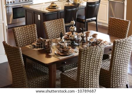 Dining room table elegantly set. - stock photo