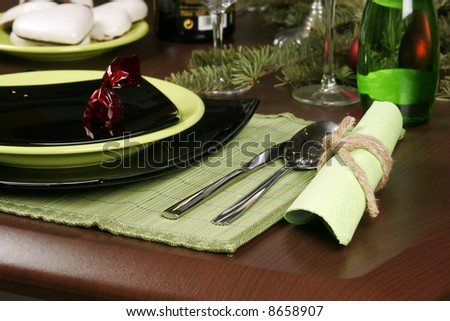 Dining room table elegantly set - stock photo