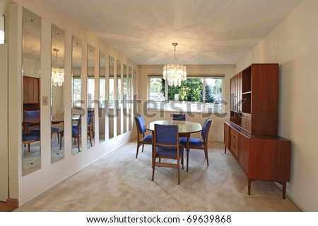 Dining room with blue chairs in sixties style