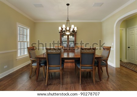 Dining room with buffet and gold walls - stock photo