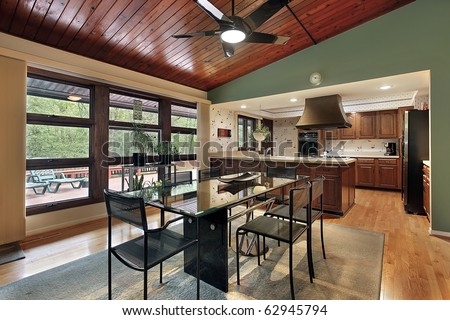Dining room with cherry wood ceiling panels - stock photo