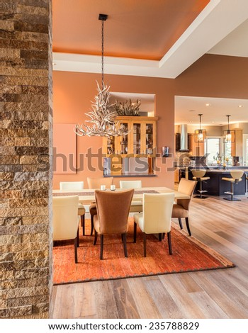 Dining Room with Entryway and View of Kitchen - stock photo